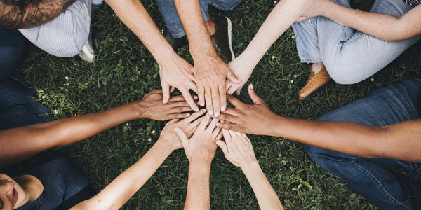 Diverse group of hands in circle.jpg